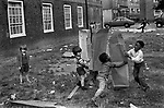 Preteen children multi ethnic children playing together south London housing estate 1970s.