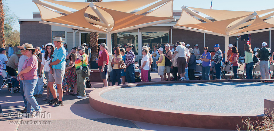 Visitors wait in line for cake at the Grand Re-Opening of the Furnace Creek Visitor Center in Death Valley National Park, California, on November 4, 2012.