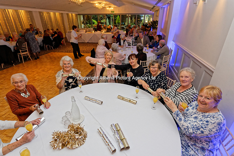 Pictured: Guests enjoy the party. Wednesday 28 November 2018<br /> Re: National Lottery millionaires from south Wales and the south west of England have hosted a glitzy Rat Pack-inspired Christmas party for an older people's music group at The Bear Hotel in Cowbridge, Wales, UK.