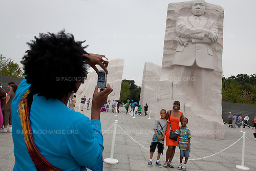 Washington, DC<br /> August 25, 2011<br /> <br /> The Martin Luther King, Jr.  Memorial in Washington, DC has brought both controversy and excitement as the four acre, $120 million site was completed. Critics were upset that Lei Yixin, a Chinese sculpture, created it. Art critics did not like his pose and many felt it was to confrontational and not how Martin Luther King Jr., should be remembered. The monument is, also, missing King's wedding band on his ring finger.<br /> <br /> But as visitors come to see it for themselves, much of the criticism fades away: In the same way that the storm of controversy around Maya Lin's Vietnam Memorial faded away, as visitors and veterans witnessed it themselves.<br /> <br /> Every day at the Martin Luther King, Jr.  Memorial, visitors stand, look up, and photograph themselves and their families with their cell phones, cameras, and iPads. Many linger and read his quotes on the granite walls. And at night as the sun sets, the monument glows as it is showered with lights.