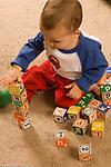 toddler boy 18 months old stacking blocks making block tower