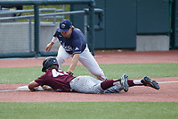 Trey McDyre (5) of the Liberty Flames applies a tag to Josh Finerty (43) of the Bellarmine Knights as he slides into third base at Liberty Baseball Stadium on March 9, 2021 in Lynchburg, VA. (Brian Westerholt/Four Seam Images)