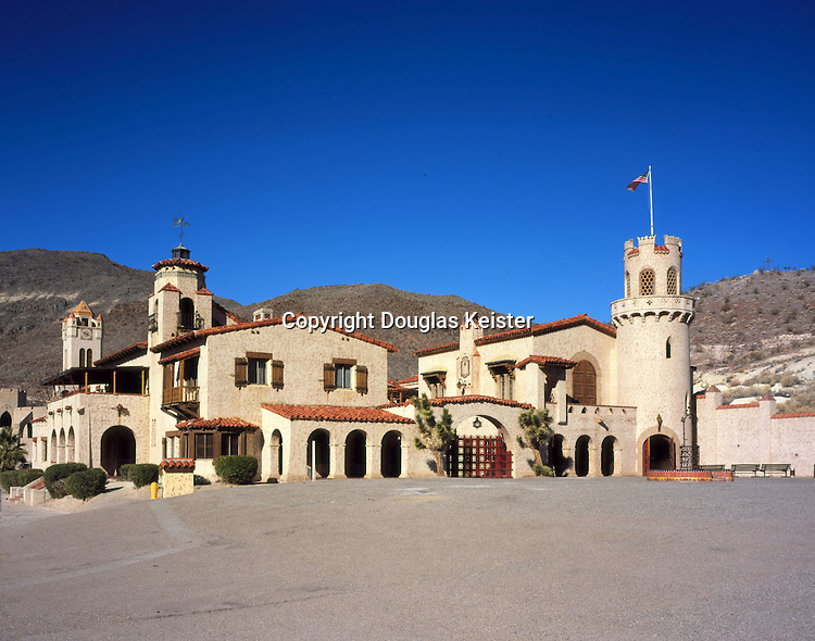 Despite its frenetic skyline, a close look at Scotty's Castle in Death Valley, California, quickly reveals the basic simplicity of its layout.  It consists of a pair of long rectangular buildings separated by a courtyard, to which a fantastical array of arcades, bays, chimneys, and turrets are somewhat randomly appended.  While the Castle's plan may be simplistic, the quality of its finishes and furnishings is nothing short of spectacular--a feat owed largely to Hungarian-born architect Martin de Debovay, who supervised the execution of its wood carving, ironwork, and tile.