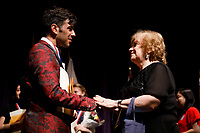 Second prize winner Valerio Lisci from Italy speaks with jury member Milda Agazarian from Russia after the awards ceremony of the 11th USA International Harp Competition at Indiana University in Bloomington, Indiana on Saturday, July 13, 2019. (Photo by James Brosher)