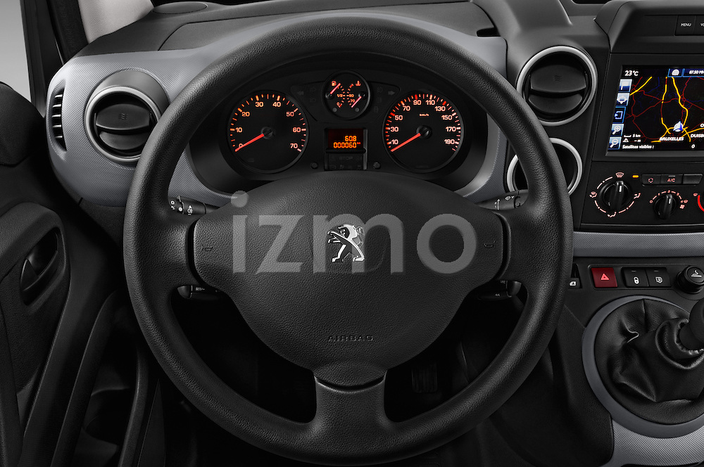 Car pictures of steering wheel view of a 2015 Peugeot Partner - 4 Door Car Van Steering Wheel
