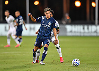 LAKE BUENA VISTA, FL - AUGUST 01: Jesús Medina #19 of New York City FC is pressured as he passes the ball during a game between Portland Timbers and New York City FC at ESPN Wide World of Sports on August 01, 2020 in Lake Buena Vista, Florida.