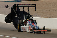 Apr 9, 2006; Las Vegas, NV, USA; NHRA Top Fuel driver Melanie Troxel, driver of the Skull Gear/Torco Race Fuels dragster slows her car down after her first round victory during final eliminations at the SummitRacing.com Nationals at Las Vegas Motor Speedway in Las Vegas, NV. Mandatory Credit: Mark J. Rebilas