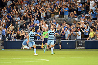 KANSAS CITY, KS - JULY 31: Graham Zusi #8 and Johnny Russell #7 Sporting KC celebrate a goal during a game between FC Dallas and Sporting Kansas City at Children's Mercy Park on July 31, 2021 in Kansas City, Kansas.