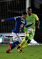 BOGOTA - COLOMBIA - 25 – 03 - 2018: Santiago Montoya (Izq.) jugador de Millonarios disputa el balón con Leonardo Escorcia (Der.) jugador de Jaguares F. C., durante partido de la fecha 10 entre Millonarios y Jaguares F. C., por la Liga Aguila I 2018, jugado en el estadio Nemesio Camacho El Campin de la ciudad de Bogota. / Santiago Montoya (L) player of Millonarios vies for the ball with Leonardo Escorcia (R) player of Jaguares F. C., during a match of the 10th date between Millonarios and Jaguares F. C., for the Liga Aguila I 2018 played at the Nemesio Camacho El Campin Stadium in Bogota city, Photo: VizzorImage / Luis Ramirez / Staff.