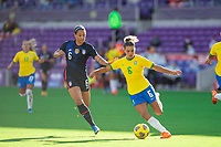ORLANDO CITY, FL - FEBRUARY 21: Lynn Williams #6 of the USWNT and Tamires battle for the ball during a game between Brazil and USWNT at Exploria Stadium on February 21, 2021 in Orlando City, Florida.