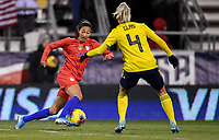COLUMBUS, OH - NOVEMBER 07: Christen Press #23 of the United States turns and moves with the ball past Sweden's Hanna Glas #4 during a game between Sweden and USWNT at MAPFRE Stadium on November 07, 2019 in Columbus, Ohio.