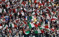 Calcio, Serie A: Juventus vs Napoli. Torino, Juventus Stadium, 23 maggio 2015. <br /> Juventus fans wave tricolor flags prior to the start of the Italian Serie A football match between Juventus and Napoli at Turin's Juventus Stadium, 23 May 2015.<br /> UPDATE IMAGES PRESS/Isabella Bonotto