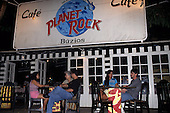 Buzios, Brazil. Planet Rock Cafe, people sitting at tables outside in the evening.