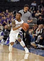 Isaiah Thomas is careful not to step out of play. The Washington Huskies defeated the Oregon State Beavers 59-52 during the Pac-10 Tournament at the Staples Center in Los Angeles, California on March 11th, 2010.