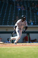 Glendale Desert Dogs right fielder Estevan Florial (13), of the New York Yankees organization, starts down the first base line during an Arizona Fall League game against the Mesa Solar Sox at Sloan Park on October 27, 2018 in Mesa, Arizona. Glendale defeated Mesa 7-6. (Zachary Lucy/Four Seam Images)