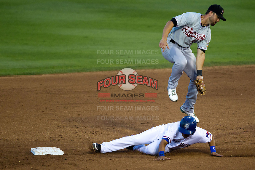 Sacramento River Cats shortstop Brandon Hicks #9 jumps over the sliding baserunner during the Pacific Coast League baseball game against the Round Rock Express on May 22, 2012 at The Dell Diamond in Round Rock, Texas. The Express defeated the River Cats 11-5. (Andrew Woolley/Four Seam Images).