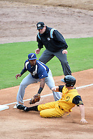Pensacola Blue Wahoos third baseman Juan Silverio (18) tags out Joe Benson (5) sliding in as umpire Jeremy Riggs looks on to make the call during a game against the Jacksonville Suns on April 20, 2014 at Bragan Field in Jacksonville, Florida.  Jacksonville defeated Pensacola 5-4.  (Mike Janes/Four Seam Images)