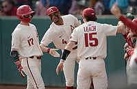 Arkansas first baseman Brady Slavens (17) is congratulated Wednesday, April 7, 2021, after hitting a three-run home run during the first inning of the Razorbacks' 10-3 win over UALR at Baum-Walker Stadium in Fayetteville. Visit nwaonline.com/210408Daily/ for today's photo gallery. <br /> (NWA Democrat-Gazette/Andy Shupe)