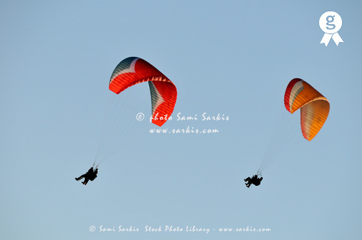 Two paragliders in air (Licence this image exclusively with Getty: http://www.gettyimages.com/detail/sb10068346c-001 )