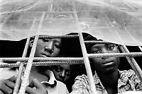 Rwanda. Gitagata. Prison for 152 children, aged 4 to 14, all convicted for active involvement (murder) in the 1994 rwandese genocide. Reeducation camp for minors. Children behind bars. © 1995 Didier Ruef