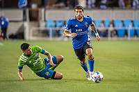 SAN JOSE, CA - MAY 12: Eric Remedi #5 of the San Jose Earthquakes looks up to pass the ball during a game between San Jose Earthquakes and Seattle Sounders FC at PayPal Park on May 12, 2021 in San Jose, California.