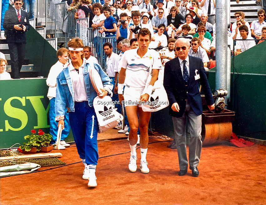 June 5, 1988, Netherlands, Ede, Audi Open, Paul Dogger (NED) (L) and Ivan Lendl (CZE) (M) enter the court<br /> Photo: Tennisimages/Henk Koster