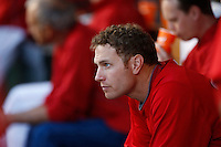 Josh Hamilton #32 of the Los Angeles Angels waits in the dugout during a game against the Los Angeles Dodgers in both teams final spring training game at Angel Stadium on March 30, 2013 in Anaheim, California. (Larry Goren/Four Seam Images)