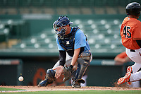 Tampa Bay Rays catcher Chris Betts (26) fields a throw as Alexis Torres (45) slides home safely during an Instructional League game against the Baltimore Orioles on October 2, 2017 at Ed Smith Stadium in Sarasota, Florida.  (Mike Janes/Four Seam Images)