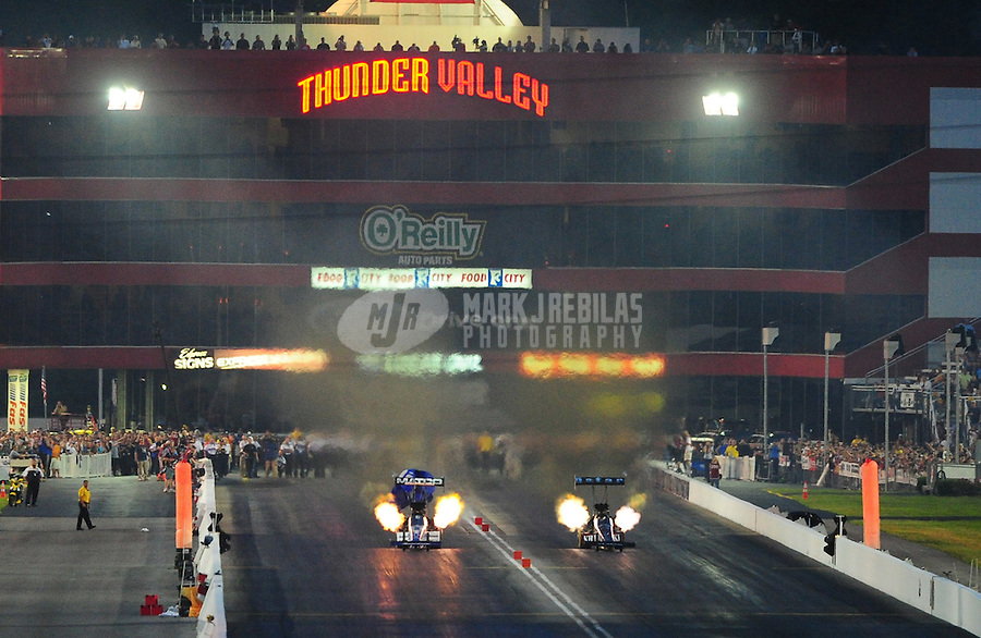 Jun. 19, 2011; Bristol, TN, USA: NHRA top fuel dragster driver Larry Dixon (right) races Antron Brown in the final round during eliminations at the Thunder Valley Nationals at Bristol Dragway. Mandatory Credit: Mark J. Rebilas-