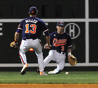 Left fielder Jeff Schaus (3) and shortstop Brad Miller (13) of the Clemson Tigers can't quite get to a ball hit by Adrian Morales in the second inning of a game against the South Carolina Gamecocks on Tuesday, March 8, 2011, at Fluor Field in Greenville, S.C.  Photo by Tom Priddy / Four Seam Images