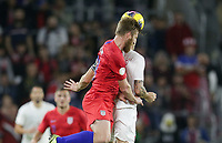 ORLANDO, FL - NOVEMBER 15: Tim Ream #13 of the United States heads a ball during a game between Canada and USMNT at Exploria Stadium on November 15, 2019 in Orlando, Florida.