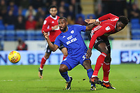 Junior Hoilett of Cardiff City wins the ball from Dominic Iorfa of Ipswich during the Sky Bet Championship match between Cardiff City and Ipswich Town at The Cardiff City Stadium, Cardiff, Wales, UK. Tuesday 31 October 2017