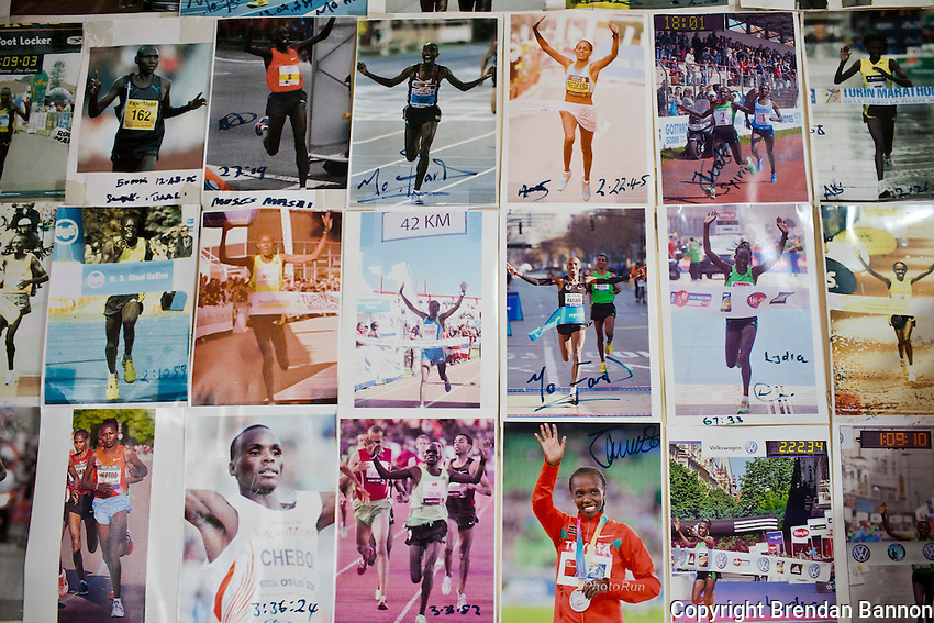 A gallery of champions in the massage and physio therapy room at Demodanna's training camp in Iten, Kenya.