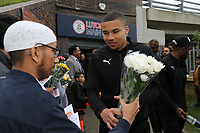 Player receives flowers - Luton Town players and staff celebrate promotion in front of supporters during an open top bus journey through the streets of Luton displaying the trophy afte gaining promotion to the EFL Championship from League One on 5 May 2019. Photo by David Horn.