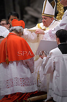 Cardinal Leopoldo Jose Brenes Solorzano of Nicaragua  receives his beret as he is being appointed cardinal by Pope Francis  at the consistory in the St. Peter's Basilica at the Vatican on February 22, 2014.