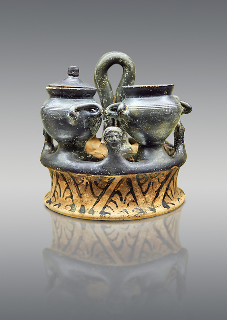 A late 4th early 3rd century B.C Etruscan Kernos, or a ceramic ring eith cups or vases, which may have been used in religious rituals, made in Teano, inv 83957, National Archaeological Museum Florence, Italy , against grey