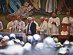 Pope Francis right and Palestinian President Mahmoud Abass  after the two celebrated mass with thousands of worshipers in Manger Square in the West Bank city of Bethlehem Sunday May 25 2014. Pope Francis is on a three day visit to the region. Photo by Eyal Warshavsky