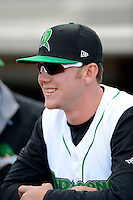 Dayton Dragons pitcher Joel Bender #19 in the dugout before a game against the Bowling Green Hot Rods on April 20, 2013 at Fifth Third Field in Dayton, Ohio.  Dayton defeated Bowling Green 6-3.  (Mike Janes/Four Seam Images)