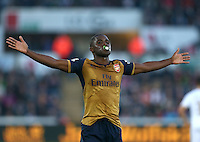 Joel Campbell of Arsenal celebrates scoring his goal to make the score 0-3 with a dummy in his mouth during the Barclays Premier League match between Swansea City and Arsenal played at The Liberty Stadium, Swansea on October 31st 2015