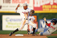 Tri-City ValleyCats second baseman Tony Kemp (2) attempts to turn a double play as Tzu-Wei Lin (7) slides in during a game against the Lowell Spinners on July 5, 2013 at Joseph L. Bruno Stadium in Troy, New York.  Tri-City defeated Lowell 5-4.  (Mike Janes/Four Seam Images)