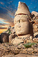 Pictures of the statues of around the tomb of Commagene King Antochus 1 on the top of Mount Nemrut, Turkey. Stock photos & Photo art prints. In 62 BC, King Antiochus I Theos of Commagene built on the mountain top a tomb-sanctuary flanked by huge statues (8–9 m/26–30 ft high) of himself, two lions, two eagles and various Greek, Armenian, and Iranian gods. The photos show the broken statues on the  2,134m (7,001ft)  mountain. 4