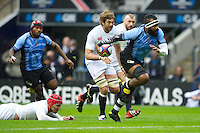 Api Naikatini of the Flying Fijians breaks past Geoff Parling of England and Tom Johnson of England (red scrum cap) during the QBE International between England and Fiji at Twickenham on Saturday 10th November 2012 (Photo by Rob Munro)