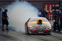 Oct. 31, 2008; Las Vegas, NV, USA: NHRA pro stock driver Jim Yates does a burnout during qualifying for the Las Vegas Nationals at The Strip in Las Vegas. Mandatory Credit: Mark J. Rebilas-