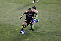 COLUMBUS, OH - DECEMBER 12: Artur #8 of the Columbus Crew is challenged for the ball by Nicolas Lodeiro #10 of the Seattle Sounders FC during a game between Seattle Sounders FC and Columbus Crew at MAPFRE Stadium on December 12, 2020 in Columbus, Ohio.