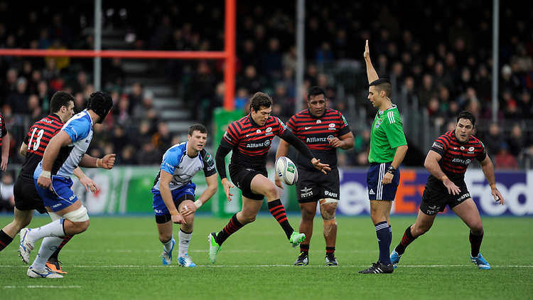 Brad Barritt of Saracens takes a quick tap penalty during the Heineken Cup Round 6 match between Saracens and Connacht Rugby at Allianz Park on Saturday 18th January 2014 (Photo by Rob Munro)