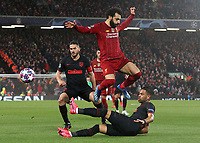 Liverpool's Mohamed Salah is tackled by Atletico Madrid's Renan Lodi <br /> <br /> Photographer Rich Linley/CameraSport<br /> <br /> UEFA Champions League Round of 16 Second Leg - Liverpool v Atletico Madrid - Wednesday 11th March 2020 - Anfield - Liverpool<br />  <br /> World Copyright © 2020 CameraSport. All rights reserved. 43 Linden Ave. Countesthorpe. Leicester. England. LE8 5PG - Tel: +44 (0) 116 277 4147 - admin@camerasport.com - www.camerasport.com
