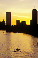 Sunrise over the Charles River with rowers and Prudential and John Hancock towers