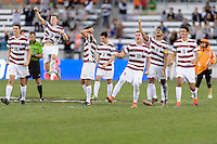 Houston, TX - Friday December 11, 2016: The Stanford Cardinal team reacts to their player making his kick in the overtime shootout against the Wake Forest Demon Deacons at the NCAA Men's Soccer Finals at BBVA Compass Stadium in Houston Texas.
