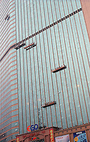 Window cleaners clean an office building in Guangzhou, China..