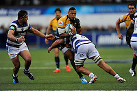 Luther Burrell of Northampton Saints is tackled by Leroy Houston of Bath Rugby during the Amlin Challenge Cup Final match between Bath Rugby and Northampton Saints at Cardiff Arms Park on Friday 23rd May 2014 (Photo by Rob Munro)